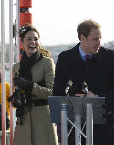 Britain&#39;s Prince William, right, looks on as his fiancee Kate Middleton prepares to pour champagne over the lifeboat during a visit Trearddur Bay Lifeboat Station on the island of Anglesey, Wales, Thursday, Feb. 24, 2011. Several hundred people cheered as Prince William and fiancee Kate Middleton made a rare public appearance Thursday to dedicate a new lifeboat. They plan to marry April 29 at Westminster Abbey.  <span class=meta>(&#40;AP Photo&#47;Jon Super&#41;)</span>